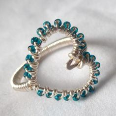 This is a very simple and sweet wire wrapped heart ring. It makes up very quickly and can be as fancy as you want it to be. Try using 2-3mm gemstone beads. Or keep it simple and have fun with colored craft wire and seed beads. #Jewelry #Pattern