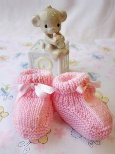 Sugary sweet and equally as cute, these candy-colored knit baby booties are the knits to beat for your little one. This darling knit baby bootie pattern is a simple way to keep baby's tiny tootsies warm and covered all season long.