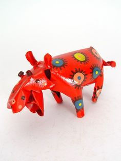 Small Tin Hippo  $24.00. Who can resist such a happy hippo? She is smiling because she was hand painted and handmade with love from recycled soda cans by artists in Zimbabwe.