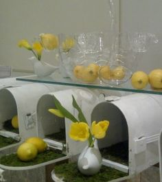 During the Tabletop show at 7 W New York,  Bess Wyrick, owner of Celadon & Celery transformed the lobby into a bright lemonade stand, Retail Details Blog, Swirlmarketing.com. Could put coats over the letter boxes and collars eyc outside