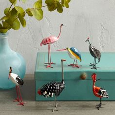 Handcrafted in Zimbabwe, these ostriches, flamingos, storks, and more are made from seedpods of the star chestnut tree. Form a fun, colorful flock on shelves and dressers, or add to a terrarium for a pop of color amongst the plants.