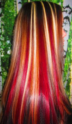 Created using Goldwell Topchic Max Reds. I would LOVE to know how they keep the red off the blonde...bubblegum pink hair is not pretty!