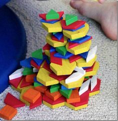 Building with pattern blocks - this type of play helps kids develop the skills they need to excel in engineering, math, and science!