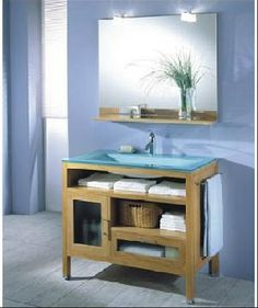 Open shelves in a bathroom vanity keep the storage light and airy.