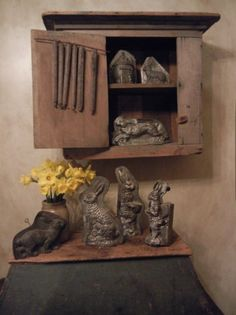 Primitive Cupboard...filled with old bunny candy molds.