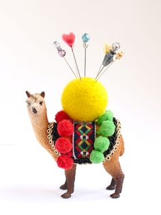 Plastic animal pin cushion.