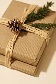 Brown paper wrappings,use butchers paper or brown post office paper or cut up brown paper bage..twine and a sprig of pine from your tree... I also use string from wrapping meat from deli or butcher. It also comes in off white. I use raffia for everything including under my tree! Its cheap and looks spiffy