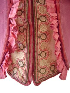 The labor of dressmakers was relatively inexpensive in the 19th century, allowing affluent women to commission and own clothing that would be considered of couture-level luxury today. This jacket has 36 velvet covered buttons pink silk trim around the cuffs, neckline and waistline....extraordinary detail, precision and care in the making. histor textilessho, cover button, velvet cover, women cloth, pink silk, button pink, fashionista histor, shell hous, 1860s women