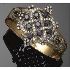 GOLD, SAPPHIRE AND DIAMOND BANGLE