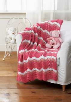 Super soft and cozy baby blanket with wavy stripes. Shown in Patons Beehive Baby Chunky.