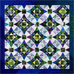 "Quilt Inspiration: ""Memories of Monet"" is a deceptively simple design by color expert Joen Wolfrom. Joen combined two historic blocks, Summer Winds and Storm at Sea, in an analogous color scheme."