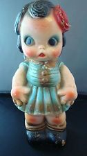 VINTAGE BABY DOLL BANK CHALKWARE