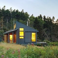 With a shed roof and corrugated siding, this off-the-grid cabin, beautifully sited on an island off the coast of New England, runs on solar power. 100% self-sustaining.