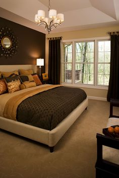 Master Bedroom. The dark wall serves as a great focal point while the neutral color of the other walls creates a warm, open, and inviting space.