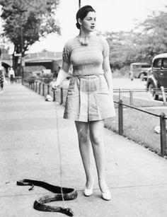 1930s Burlesque dancer Zorita walks her pet snake.