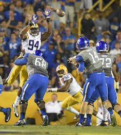 Advocate staff photo by TRAVIS SPRADLING --  LSU defensive end Danielle Hunter (94) bats down a pass by Kentucky quarterback Patrick Towles in the first quarter Saturday night in Tiger Stadium.