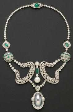 Platinum, Diamond, and Emerald Necklace, composed of Art Deco elements, centering a bezel-set old mine-cut diamond measuring approx. 8.89 x 8.20 x 5.32 mm and weighing approx. 2.50 cts., approx. total diamond wt. 19.00 cts., cultured and mabe pearl highlights, lg. 15 1/2 in., completed by a clasp signed Cartier NY.   Via Skinner.