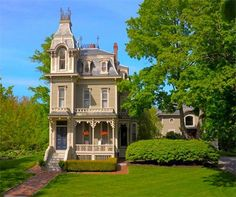 A narrow Victorian house in Kennebunk, Maine, built in 1875.  The garage is the original carriage house.