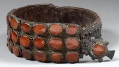 Serbia | Belt; Leather with 39 carnelian cabochons and brass studs | ca. 1800 | Est. 2000/3000 €