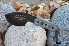 """TOPS ATM American Trail Master Knife. The TOPS Knives ATM-01 ATM Knife features a 4.0"""" blade of 1095 High Carbon Alloy hardened to RC 58. Overall Length: 9.0"""", Blade Thickness: .25"""", Blade color: Tactical Black. Handle material: Black Linen Micarta. http://www.osograndeknives.com/catalog/fixed-blade-hunting-knives/tops-atm-american-trail-master-knife-6667.html"""