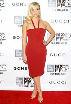 Reese Witherspoon dazzled in a red Calvin Klein Collection dress with bronze sandals.