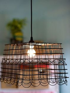 Wire basket made into a hanging pendant light.  Love this!