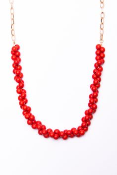 red beaded necklace.