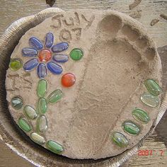 Footprint Garden Stepping Stone  Do this every year to watch a child's growth