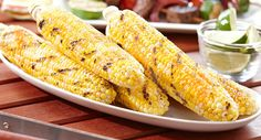 Sweet corn finished with butter, seasoned salt and lime.