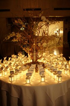 Lantern lit place cards create a glowing romantic look and a unique gift for the guests