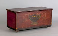 """Ohio painted poplar blanket chest, attributed to Valentine Yoder, ca. 1840, the front decorated with large urn overflowing with floral vines on a red ground, 20 3/4"""" h., 41"""" w"""