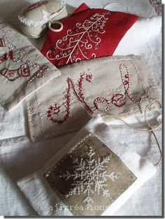 Christmas embroidery ... so pretty! I really need to take up embroidery.