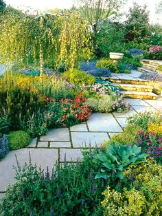 Traditional Design: In this traditional garden design, stepping stones set on the diagonal draw the eye up the steps and to the stone urn, naturally leading you through the garden. From HGTV.com's Garden Galleries