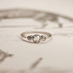 Three stone round diamonds