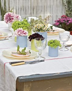 Painting tin cans in your wedding colors and put in small bunches of flowers or herbs-Definitely doing this! Easy and inexpensive