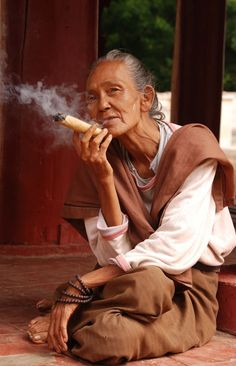 Myanmar Woman and her cigar- Reminds me of being in Burma!