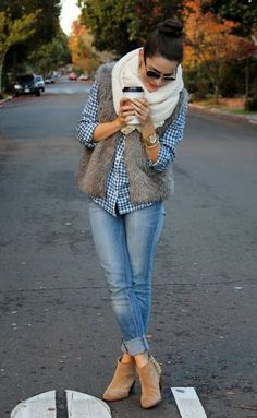 Adorable fall combination of white scarf, plaid shirt, jeans and ankle boots.