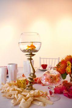 fishbowl centerpieces, photo by Sean and Amanda Photography http://ruffledblog.com/dr-seuss-wedding-inspiration #weddingideas #reception