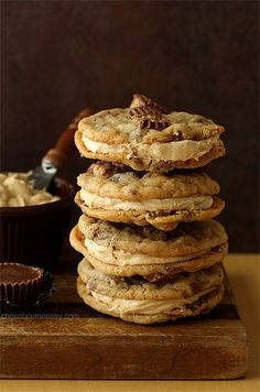 Peanut Butter Cup Sandwich Cookies - peanut butter dough, peanut butter cups, and peanut butter filling. Triple the peanut butter love <3