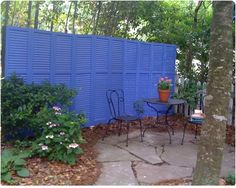 Turn old shutters into a privacy fence, hmmm, now I need to find someone with old shutters and maybe we can sit on the patio without the neighbors dog barking non-stop...