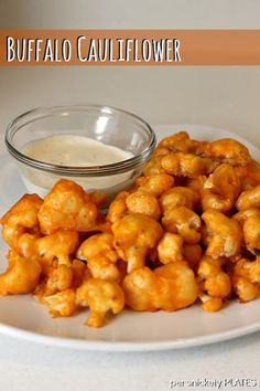 Buffalo cauliflower: If you like buffalo chicken wings, make this recipe. NOW. We just made and ate two whole pans of this. DELICIOUS.