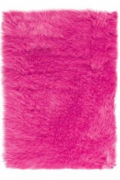 She LOVES this pink furry rug!