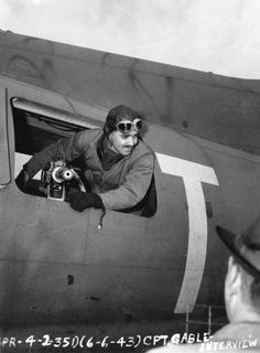 Clark Gable (1901-1960) served as an aerial gunner on a B-17 during World War II. He signed up for duty following the tragic death of his wife Carole Lombard, who was on a war bond tour when her plane crashed. He is seen here giving an interview from his waist-gunner position aside a .50 caliber Browning M2 machine gun. (June 6, 1943) gabl serv, tragic death, carole lombard, carol lombard, movi star, clarks, war ii, war bond, clark gable