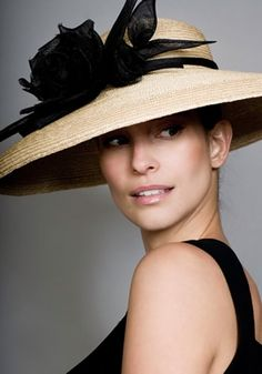 I love this downturn design by Rachel Trevor-Morgan, royal hat designer.  Her designs range in price from 400-1500 pounds!  Just imagine paying 1500 pounds (that's more than $1500) for a hat.