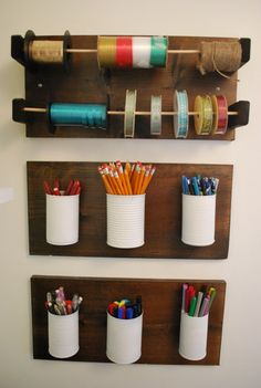 Painted white cans attached to wood. Decorative and neat.