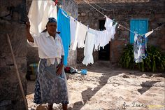 Beautiful old woman doing the wash with her hands, and smoking a pipe at the same time, on Santo Antão - Cape Verde 2011  See more fotos on Facebook   My website     How to find sexy women. Learn more on cougarsplace.com