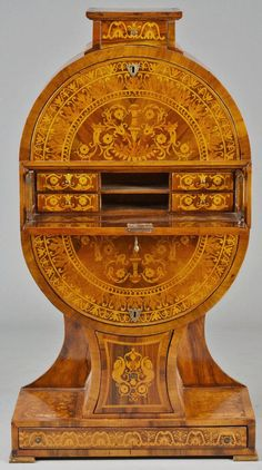 UNUSUAL AND RARE MARQUETRY SECRETARY  German. Late 19th Century.