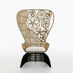CRINOLINE ARMCHAIR WITH HIGH BACK designed by Patricia Urquiola. Available through Switch Modern.