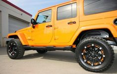 This Jeep has been sold! Orange Custom Designed 2012 Jeep Wrangler - featuring: Lift Kit, Colour Accented Rims, & Off Road Tires