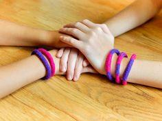 Easy DIY felted bracelets ... great summer craft for the kids! #craft #bracelets #DIY #yarn #knitting